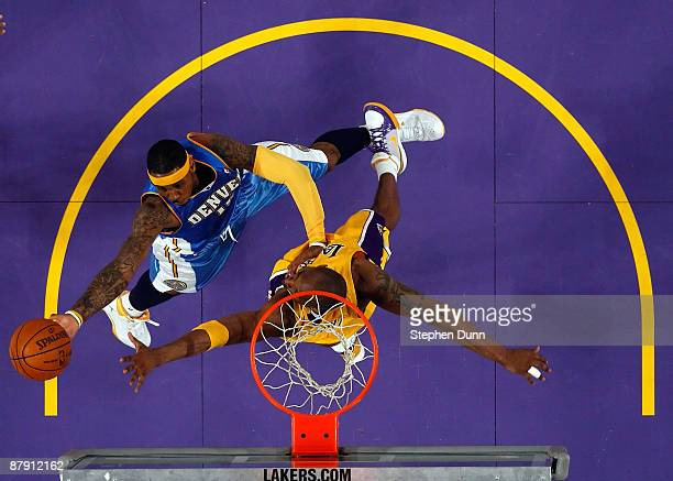 Carmelo Anthony of the Denver Nuggets goes up for a shot over Kobe Bryant of the Los Angeles Lakers in Game Two of the Western Conference Finals...