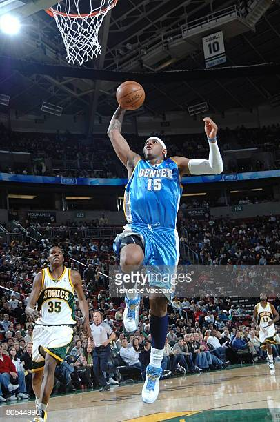 Carmelo Anthony of the Denver Nuggets goes up for the dunk against the Seattle SuperSonics at the Key Arena April 6 2008 in Seattle Washington NOTE...