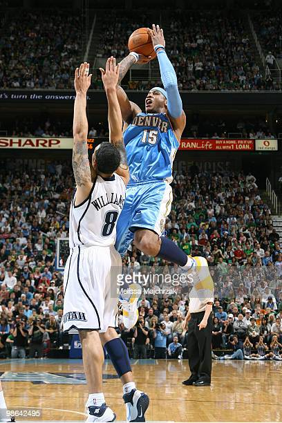 Carmelo Anthony of the Denver Nuggets goes up for the shot over Deron Williams of the Utah Jazz in Game Three of the Western Conference Quarterfinals...