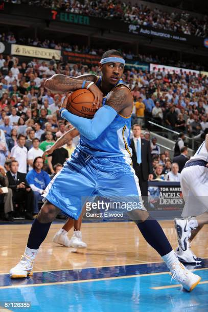 Carmelo Anthony of the Denver Nuggets grabs a rebound against the Dallas Mavericks during Game Four of the Western Conference Semifinals during the...