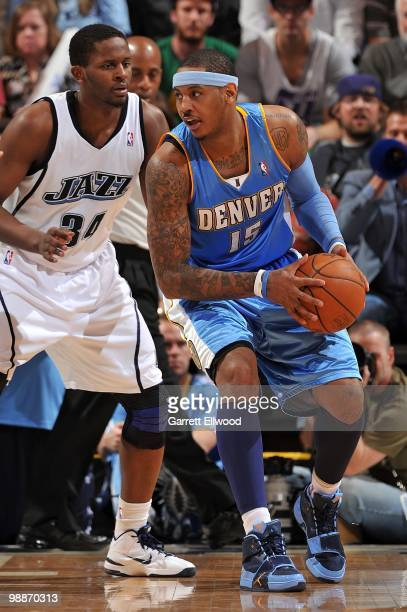 Carmelo Anthony of the Denver Nuggets handles the ball against CJ Miles of the Utah Jazz in Game Six of the Western Conference Quarterfinals during...