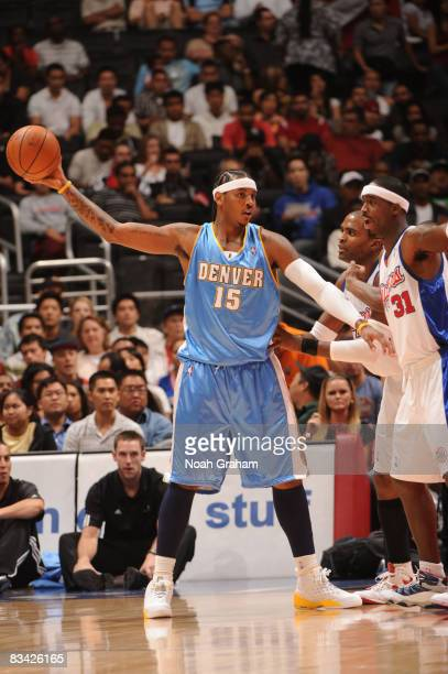 Carmelo Anthony of the Denver Nuggets holds the ball against Ricky Davis of the Los Angeles Clippers at Staples Center on October 24 2008 in Los...
