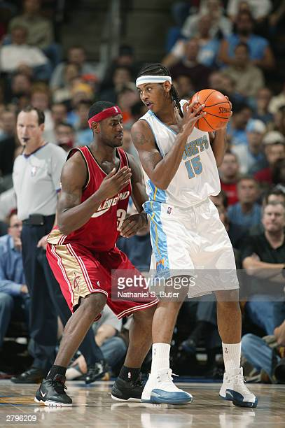 Carmelo Anthony of the Denver Nuggets is defended by LeBron James of the Cleveland Cavaliers during the game at the Pepsi Center in Denver, Colorado...