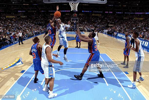 Carmelo Anthony of the Denver Nuggets lays up a shot as Quentin Richardson of the New York Knicks defends as the Knicks defeated the Nuggets 109107...