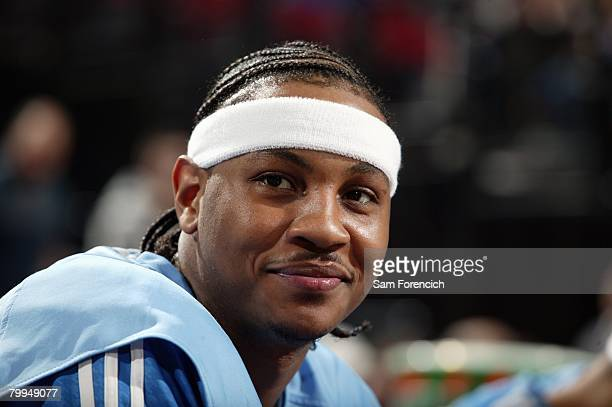 Carmelo Anthony of the Denver Nuggets looks on during the game against the Portland Trail Blazers at the Rose Garden Arena on February 4 2008 in...