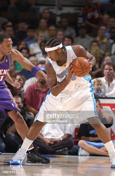 Carmelo Anthony of the Denver Nuggets looks to make a move on Shawn Marion of the Phoenix Suns during the NBA preseason game at Pepsi Center on...