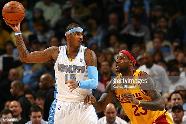 Carmelo Anthony of the Denver Nuggets looks to pass against Lebron James of the Cleveland Cavaliers on December 19, 2008 at the Pepsi Center in...