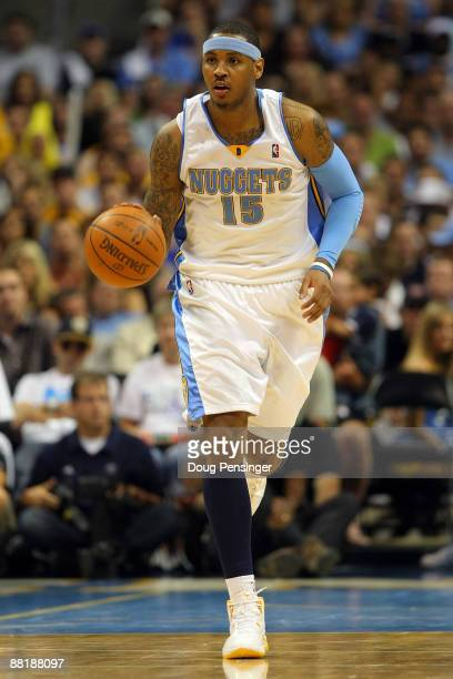 Carmelo Anthony of the Denver Nuggets moves the ball in Game Six of the Western Conference Finals during the 2009 NBA Playoffs against the Los...