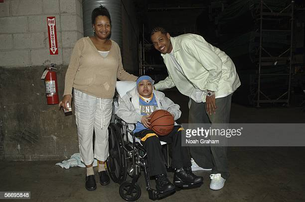 Carmelo Anthony of the Denver Nuggets poses for a picture with LeDarius Williams who has Lupus and his mom Reginas for the Make a Wish Foundation...