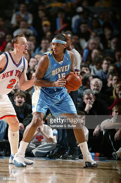 Carmelo Anthony of the Denver Nuggets posts up against Keith Van Horn of the New York Knicks during the game at Madison Square Garden on December 13...