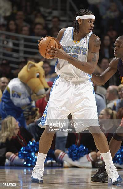 Carmelo Anthony of the Denver Nuggets posts up during the game against the Golden State Warriors at the Pepsi Center on December 5 2003 in Denver...