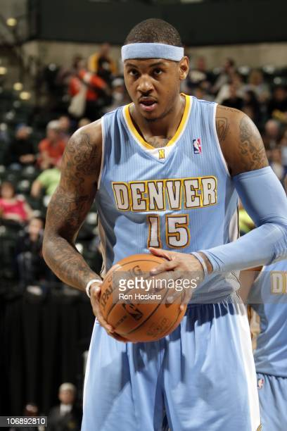 Carmelo Anthony of the Denver Nuggets prepares to shoot a free throw during a game on November 9 2010 at the Conseco Fieldhouse in Indianapolis...