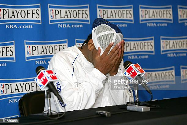 Carmelo Anthony of the Denver Nuggets puts his head in his hands during the press conference after the game against the San Antonio Spurs in Game...