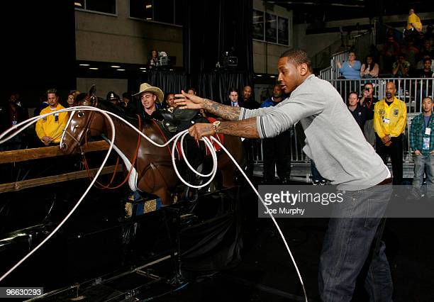 Carmelo Anthony of the Denver Nuggets ropes a fake calf during the 2010 NBA AllStar Celebrity Game presented by FINAL FANTASY XIII on center court...