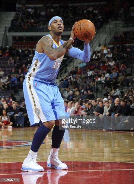 Carmelo Anthony of the Denver Nuggets shoots a free throw during a game against the Detroit Pistons on January 26 2011 at The Palace of Auburn Hills...