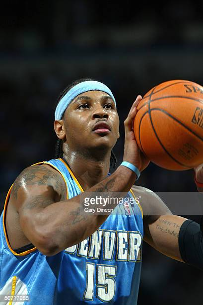Carmelo Anthony of the Denver Nuggets shoots a free throw during the game with the Milwaukee Bucks at the Bradley Center on January 14 2006 in...