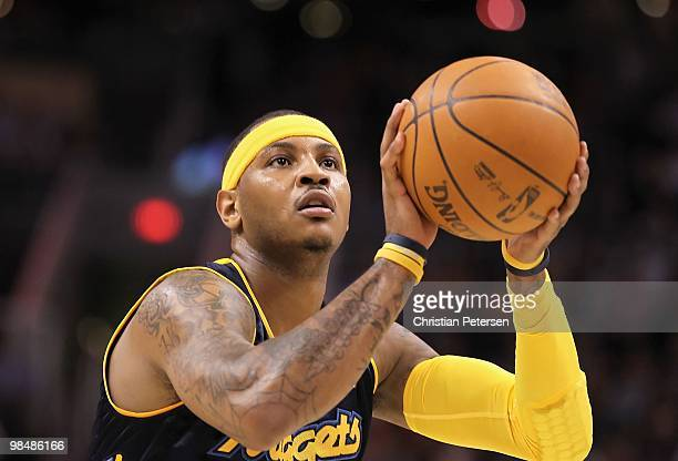 Carmelo Anthony of the Denver Nuggets shoots a free throw shot during the NBA game against the Phoenix Suns at US Airways Center on April 13 2010 in...
