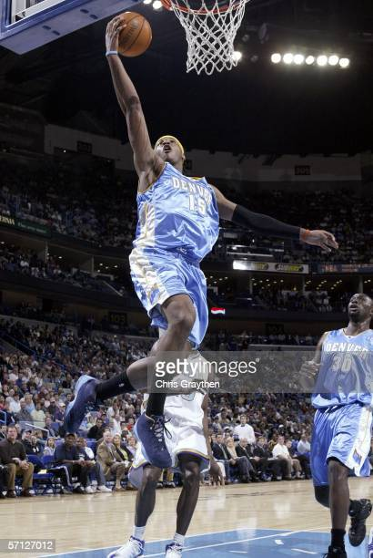 Carmelo Anthony of the Denver Nuggets shoots a layup against the New Orleans/Oklahoma City Hornets on March 18 2006 at the New Orleans Arena in New...