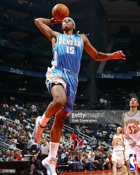 Carmelo Anthony of the Denver Nuggets shoots against the Atlanta Hawks during a game December 9, 2003 at Philips Arena in Atlanta, Georgia. NOTE TO...