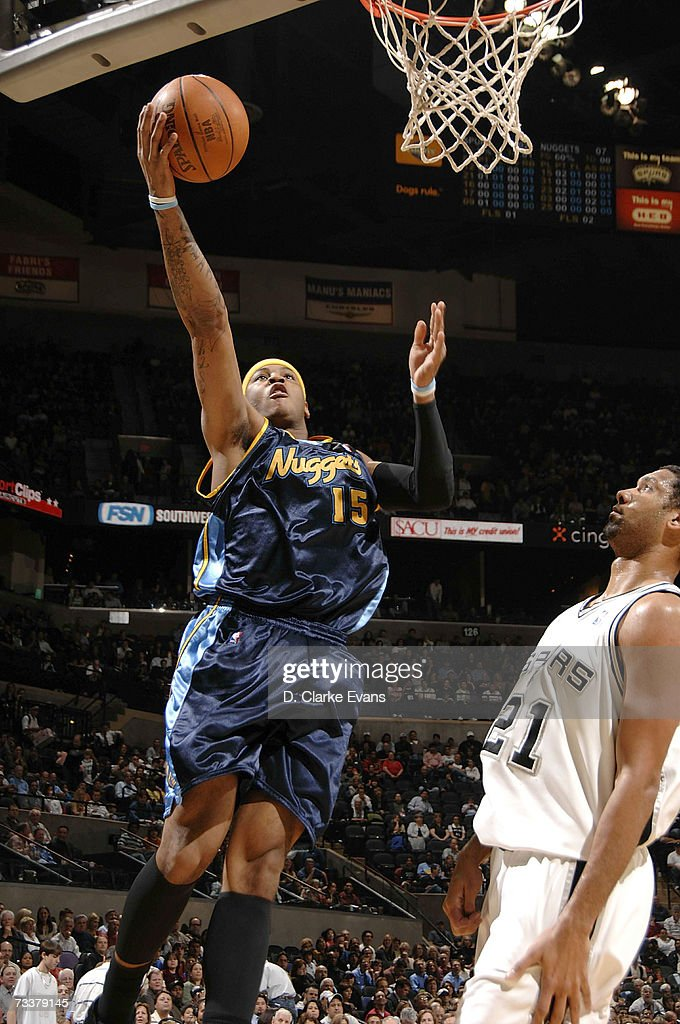 Carmelo Anthony #15 of the Denver Nuggets shoots against Tim Duncan #21 of the San Antonio Spurs on February 20, 2007 at the AT&T Center in San Antonio, Texas.