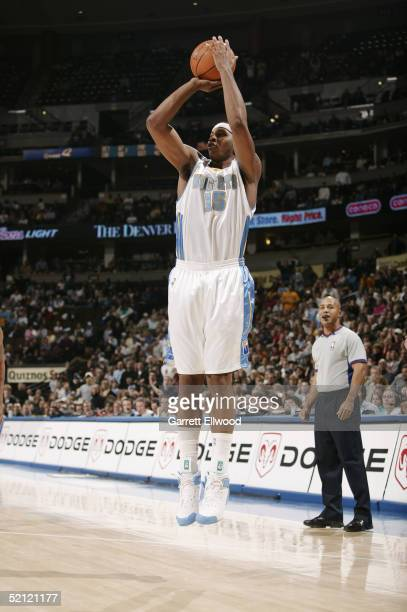 Carmelo Anthony of the Denver Nuggets shoots during the game with the Minnesota Timberwolves January 14 2005 at Pepsi Center in Denver Colorado The...