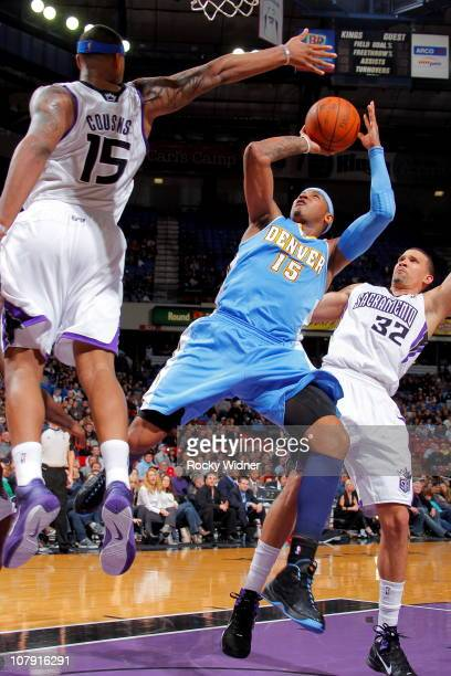 Carmelo Anthony of the Denver Nuggets shoots the ball over DeMarcus Cousins of the Sacramento Kings on January 6 2011 at ARCO Arena in Sacramento...