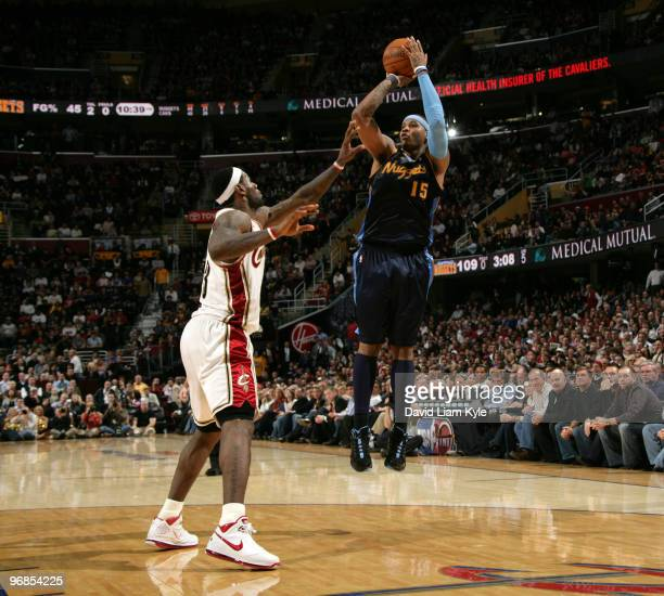 Carmelo Anthony of the Denver Nuggets shoots the jumper over LeBron James of the Cleveland Cavaliers on February 18 2010 at The Quicken Loans Arena...
