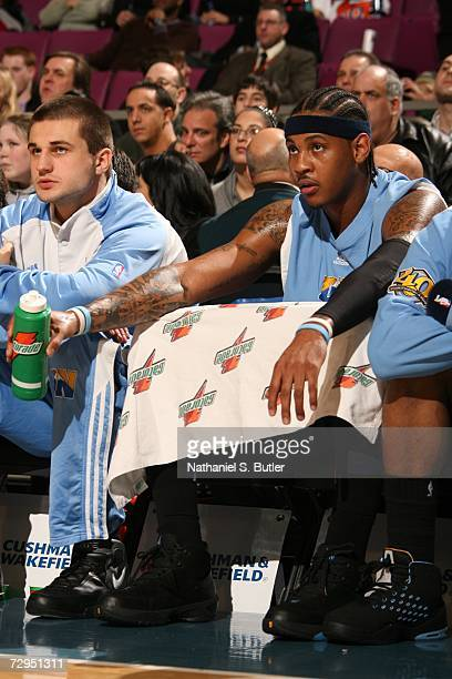 Carmelo Anthony of the Denver Nuggets sits on the bench during the NBA game against the New York Knicks on December 16 2006 at Madison Square Garden...