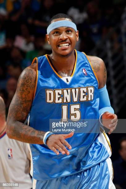 Carmelo Anthony of the Denver Nuggets smiles after sinking a threepointer against the New Orleans Hornets in Game Four of the Western Conference...