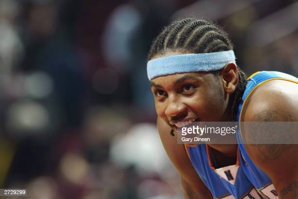 Carmelo Anthony of the Denver Nuggets smiles during the game against the Chicago Bulls at the United Center on November 10 2003 in Chicago Illinois...