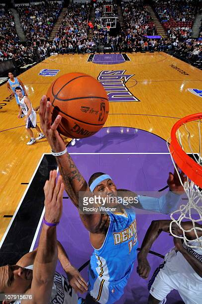 Carmelo Anthony of the Denver Nuggets takes the ball to the basket against the Sacramento Kings on January 6 2011 at ARCO Arena in Sacramento...