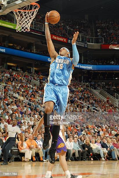 Carmelo Anthony of the Denver Nuggets takes the ball to the basket against the Phoenix Suns during the game at US Airways Center on March 30 2007 in...