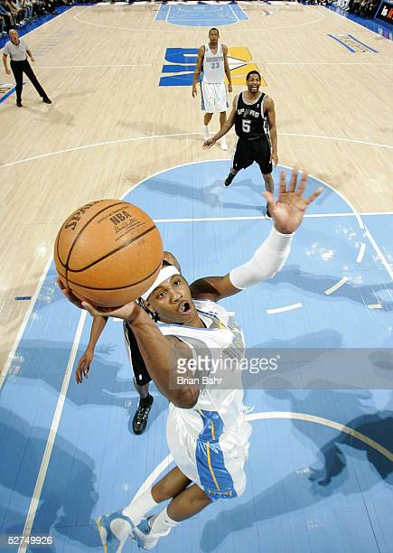 Carmelo Anthony of the Denver Nuggets takes the ball to the net against the San Antonio Spurs in the first quarter of Game four of the Western...