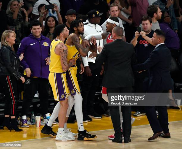 Carmelo Anthony of the Houston Rockets and Brandon Ingram of the Los Angeles Lakers have words as Lonzo Ball of the Los Angeles Lakers separates them...
