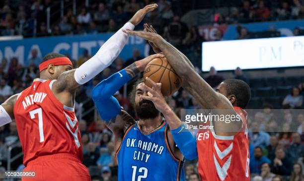Carmelo Anthony of the Houston Rockets and Gary Clark of the Houston Rockets block Steven Adams of the Oklahoma City Thunder from shooting two points...