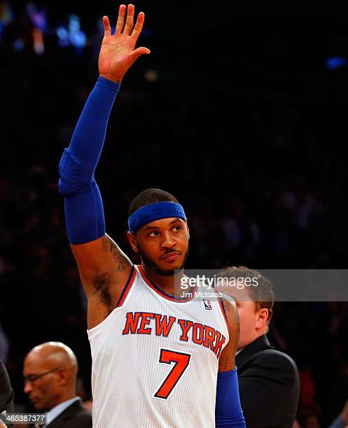 Carmelo Anthony of the New York Knicks acknowledges the crowd as he leaves a game against the Charlotte Bobcats after scoring his team record 62nd...
