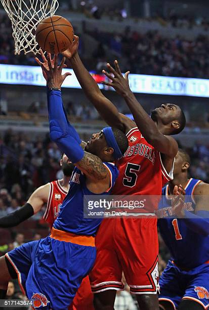 Carmelo Anthony of the New York Knicks and Bobby Portis of the Chicago Bulls battle for a rebound at the United Center on March 23 2016 in Chicago...