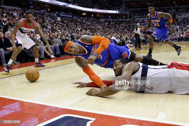 Carmelo Anthony of the New York Knicks and John Wall of the Washington Wizards go after a loose ball during the second half of the Knicks 9688 win at...