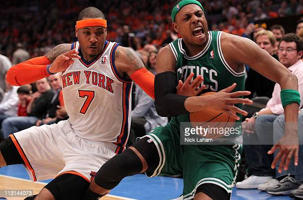 Carmelo Anthony of the New York Knicks and Paul Pierce of the Boston Celtics fight for control of a loose ball in the second half of Game Four of the...