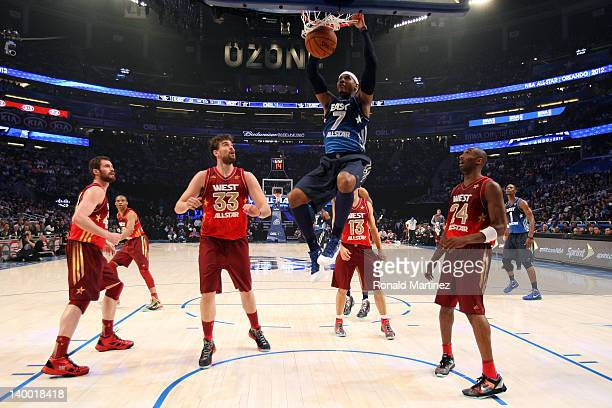 Carmelo Anthony of the New York Knicks and the Eastern Conference dunks Kobe Bryant of the Los Angeles Lakers and the Western Conference during the...