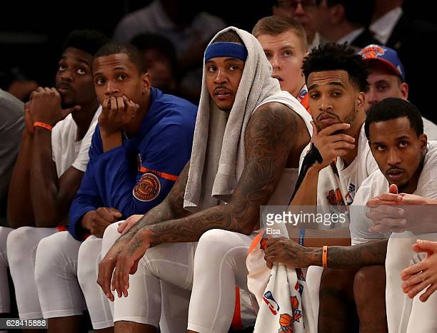 Carmelo Anthony of the New York Knicks and the rest of the bench react to the loss to the Cleveland Cavaliers at Madison Square Garden on December 7...