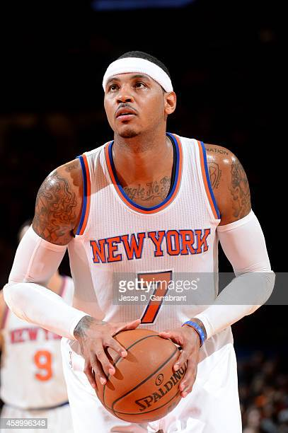 Carmelo Anthony of the New York Knicks attempts a free throw against the Utah Jazz on November 14 2014 at Madison Square Garden in New York City NOTE...