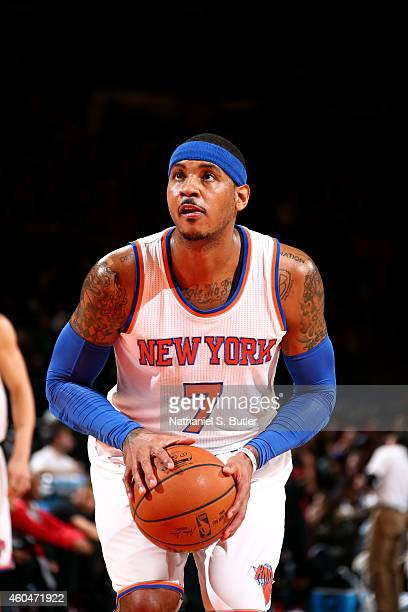 Carmelo Anthony of the New York Knicks attempts a free throw against the Toronto Raptors at Madison Square Garden on December 14 2014 in New York...