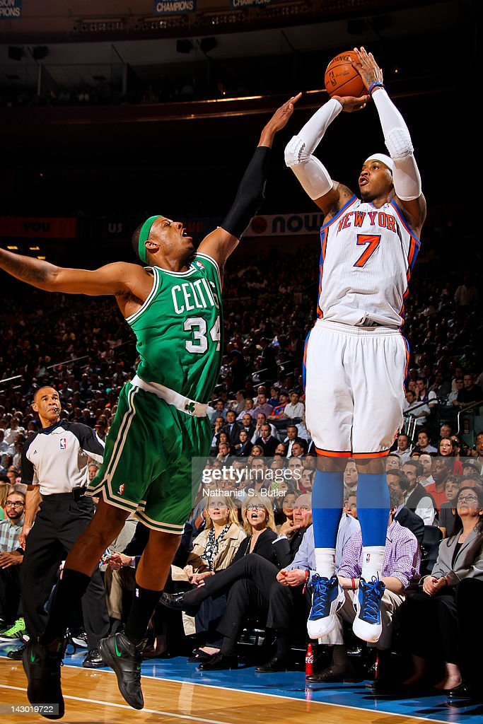 Carmelo Anthony #7 of the New York Knicks attempts a three-point shot against Paul Pierce #34 of the Boston Celtics on April 17, 2012 at Madison Square Garden in New York City.