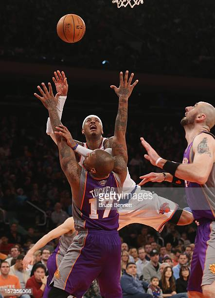 Carmelo Anthony of the New York Knicks attempts the third quarter basket over PJ Tucker of the Phoenix Suns at Madison Square Garden on December 2...