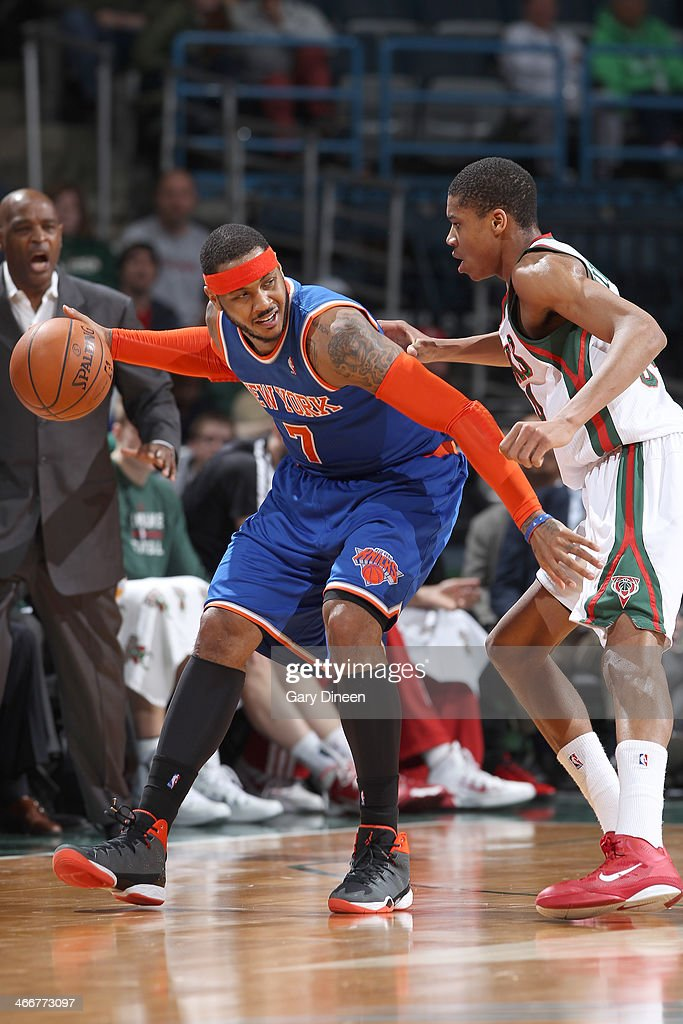 Carmelo Anthony #7 of the New York Knicks backs down Giannis Antetokounmpo #34 of the Milwaukee Bucks on February 3, 2014 at the BMO Harris Bradley Center in Milwaukee, Wisconsin.