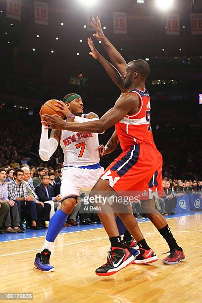 Carmelo Anthony of the New York Knicks battles a double team from Martell Webster of the Washington Wizards and Trevor Ariza of the Washington...