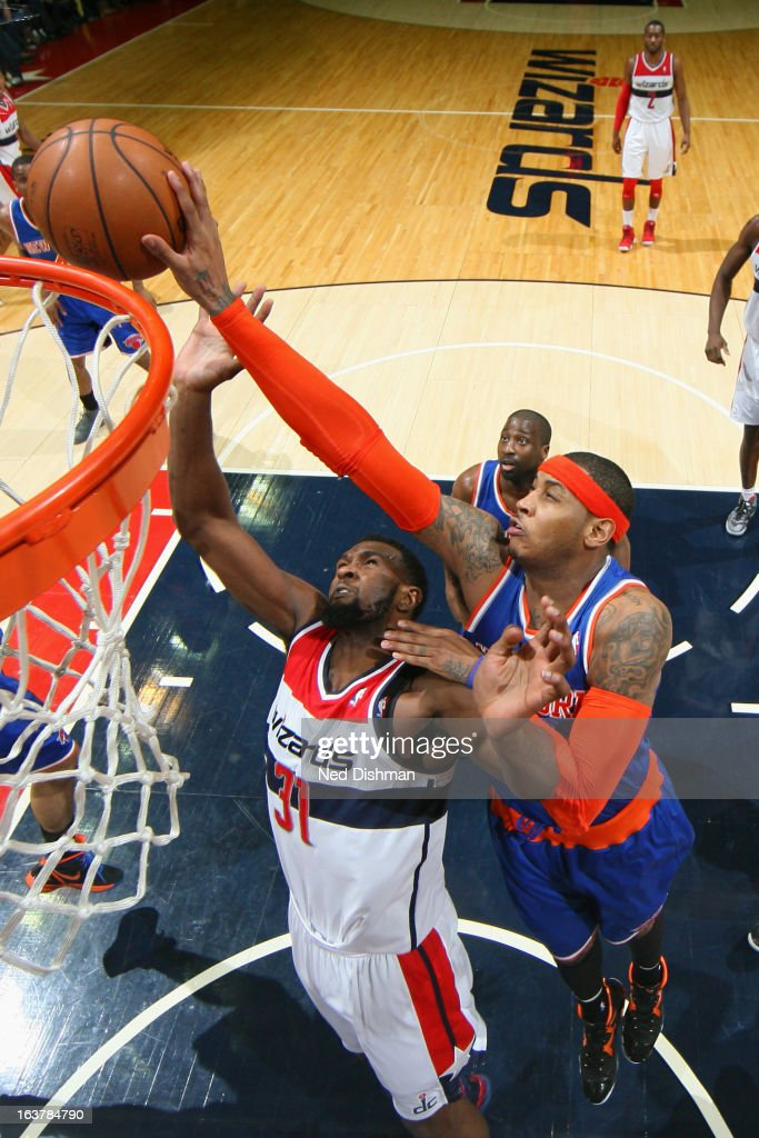Carmelo Anthony #7 of the New York Knicks blocks a shot against Chris Singleton #31 of the Washington Wizards at the Verizon Center on March 1, 2013 in Washington, DC.