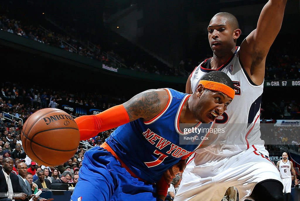 Carmelo Anthony #7 of the New York Knicks drives against Al Horford #15 of the Atlanta Hawks at Philips Arena on November 13, 2013 in Atlanta, Georgia.