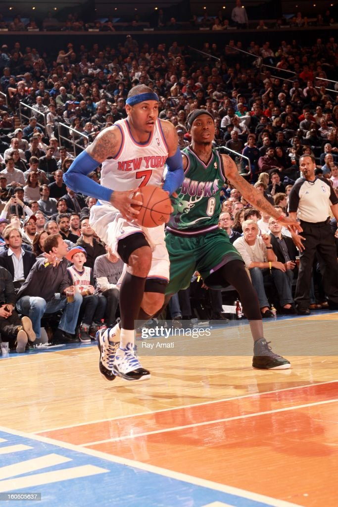 Carmelo Anthony #7 of the New York Knicks drives against Marquis Daniels #6 of the Milwaukee Bucks on February 1, 2013 at Madison Square Garden in New York City .